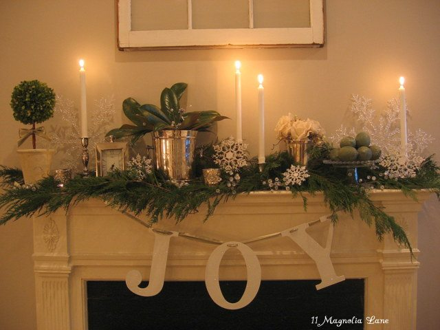 white, green, and silver Christmas mantel