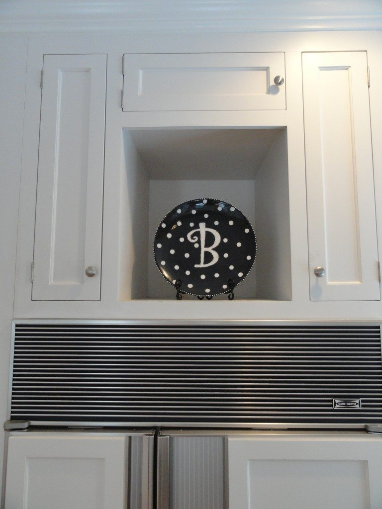 B plate on top of refrigerator