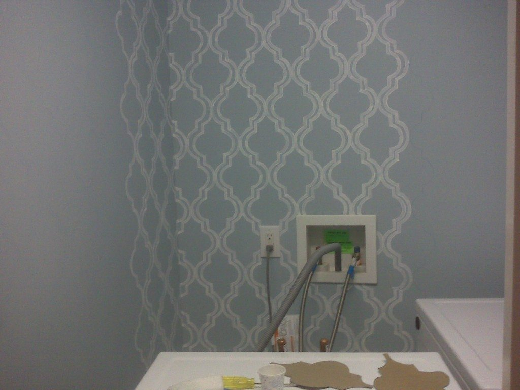 "This is my only shot of ""during"" the wallpaper painting, taken on my phone, so it's probably not the best quality. Notice the patterns on the washing machine--I traced those a thousand times!"