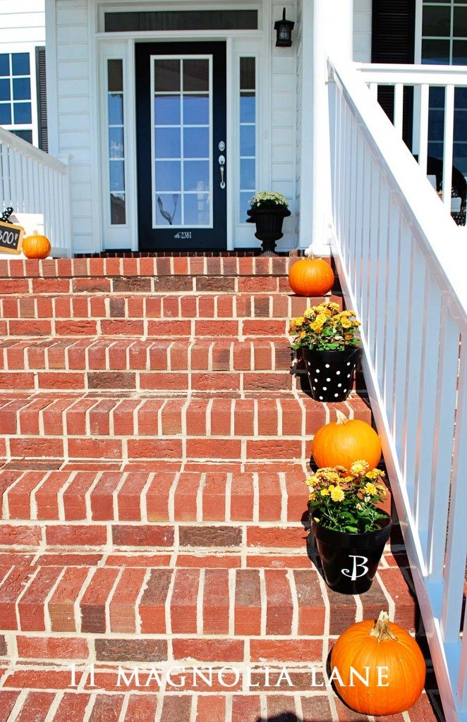 fall pumpkins and monogrammed pots on stairs from 11 Magnolia Lane