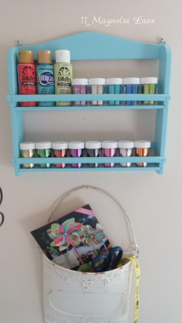 spice rack to organize bottles of acrylic paint