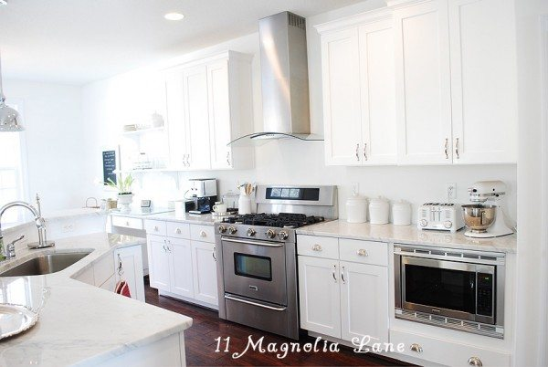 White Kitchen with Carrera Marble Counters and Stainless Appliances