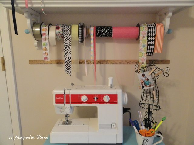 wood dowel to organize craft ribbon