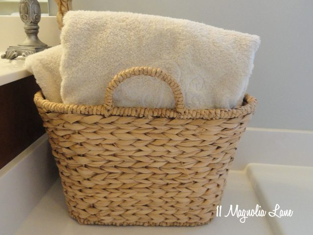 seagrass basket holding towels