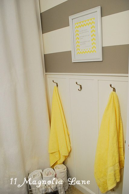 Gray and yellow kids' bath | 11 Magnolia Lane