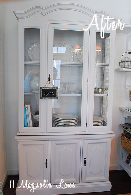 Grey painted hutch with chicken wire for kitchen storage