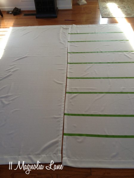 Dining room drapes taped for painting