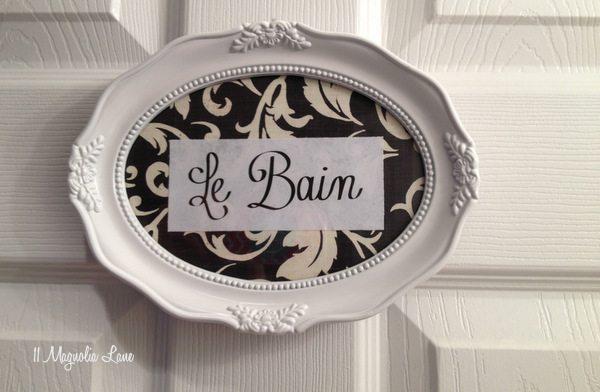 Le Bain powder room sign at 11 Magnolia Lane