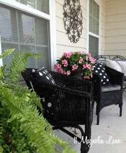 Covered front porch decorated with black, white, and pink