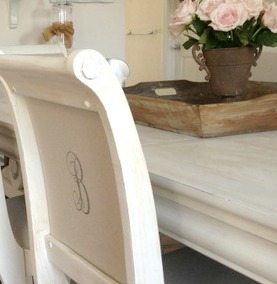 Dining room table and chairs--painted white, recovered, and monogrammed | 11 Magnolia Lane