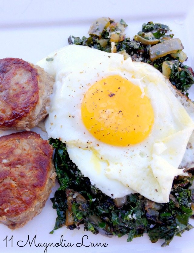Eggs over easy with sausage patty and kale hash