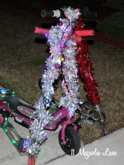 scooters with tinsel and lights