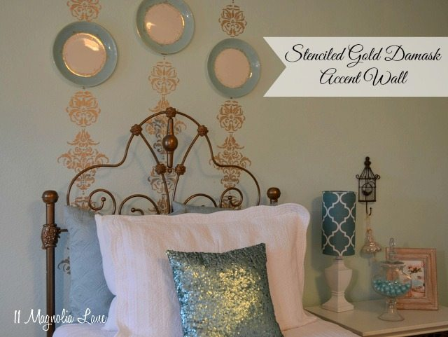 Stenciled gold damask accent wall in a girl's bedroom.