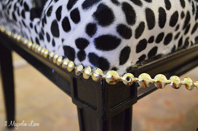 Black cane bench with dalmation print seat and gold nail head trim | 11 Magnolia Lane
