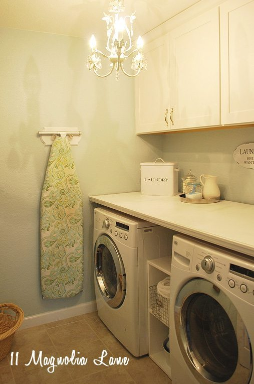 Laundry room with chandelier and DIY folding table | 11 Magnolia Lane