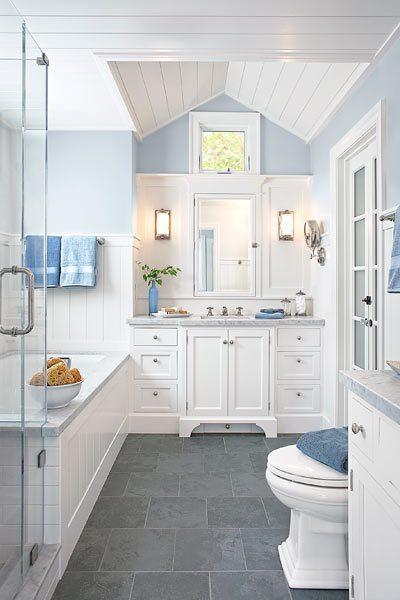 Light bathroom with dark grey tile