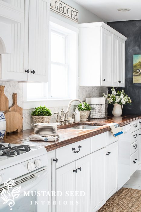 White kitchen with butcher block countertops