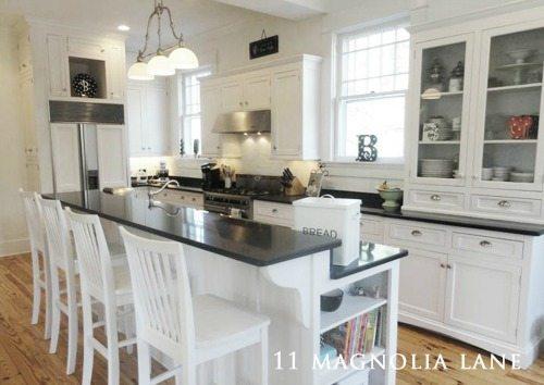 White kitchen with black granite countertops