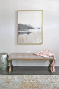 Beautiful artwork from Minted paired with a rustic bench makes for a welcoming entryway.