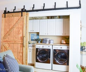 Laundry room closet with DIY sliding barn doors | 11 Magnolia Lane