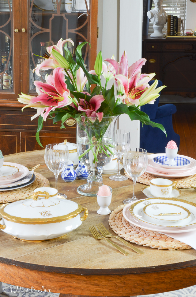 Easter spring table setting with blue willow china, gold and white monogrammed vintage Limoges porcelain, blue gingham appetizer plates, and gold flatware | 11 Magnolia Lane